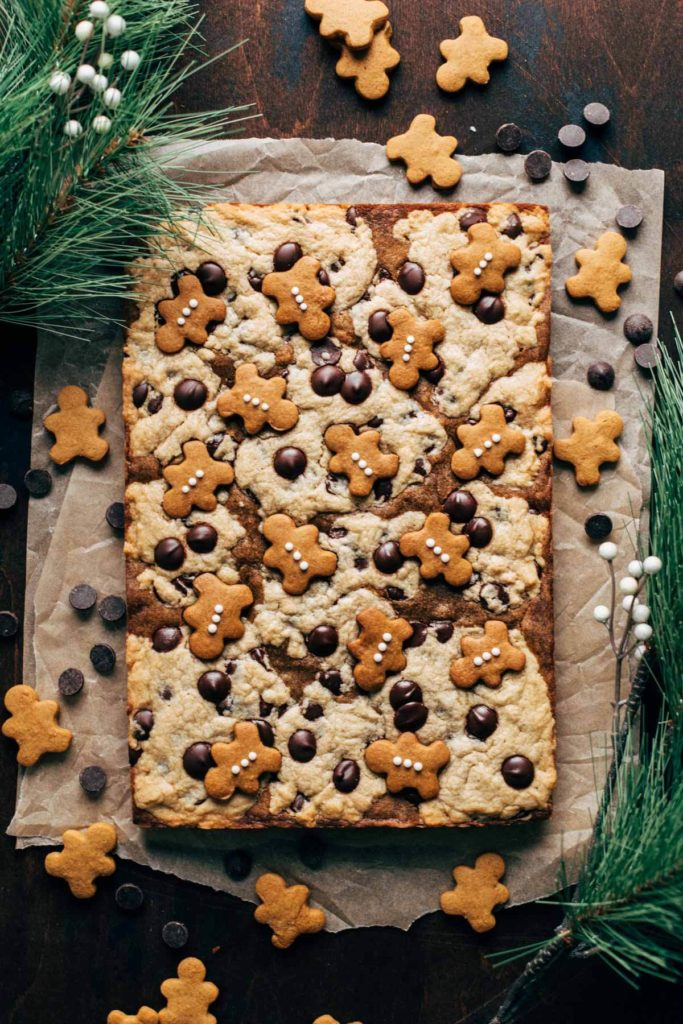 the top of baked gingerbread cookie bars topped with mini gingerbread cookies