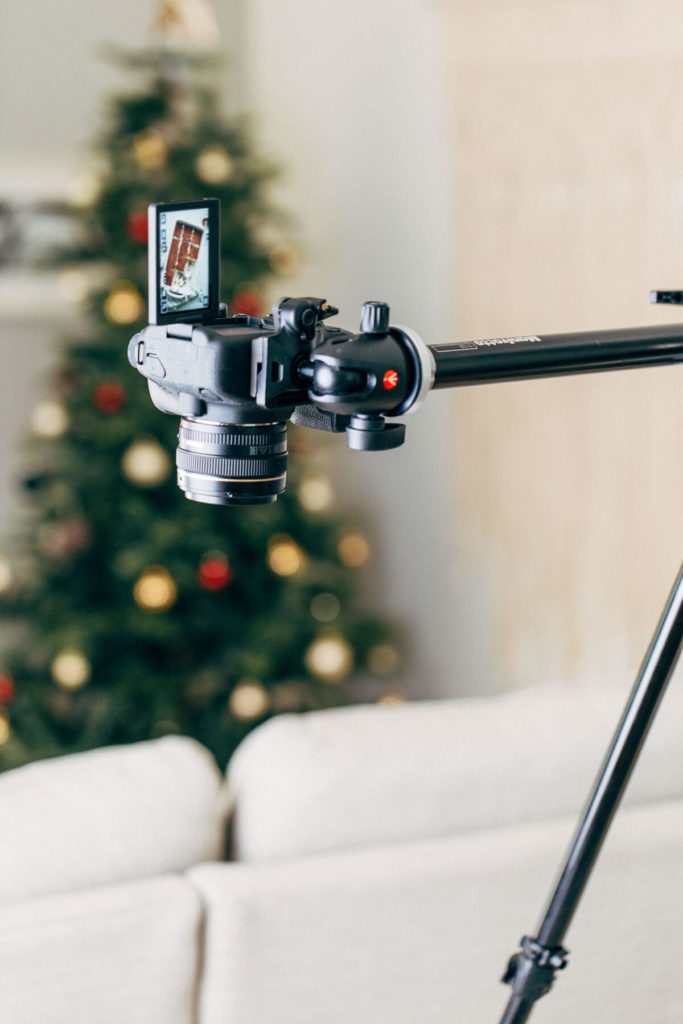 a camera mounted on an overhead tripod