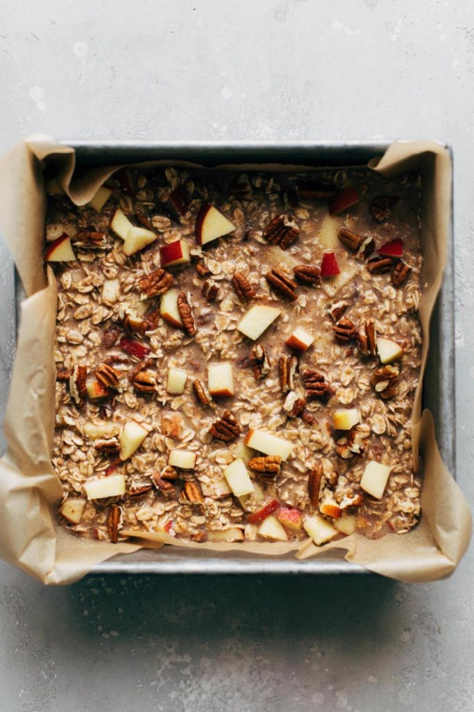 apple cinnamon pecan baked oatmeal batter in baking pan