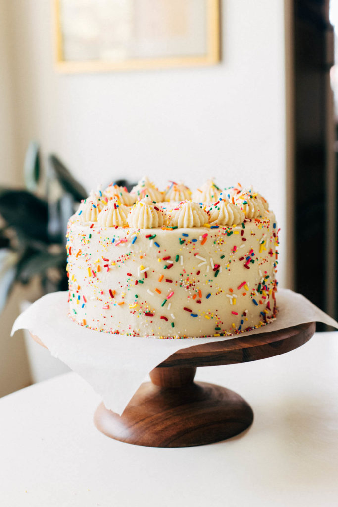 final frosted cake on a cake stand