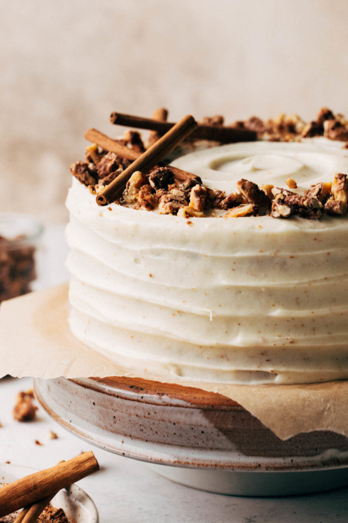 close up on the outside of a spice cake covered in brown butter cream cheese frosting