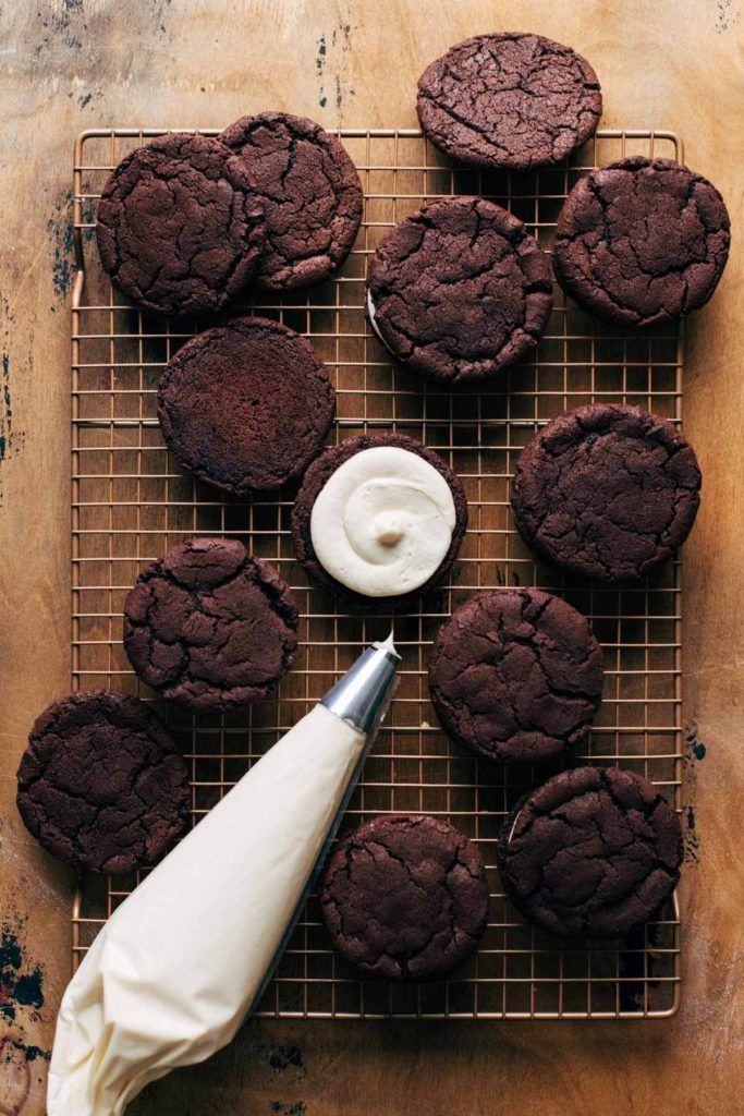 irish cream filling piped on a chocolate cookie