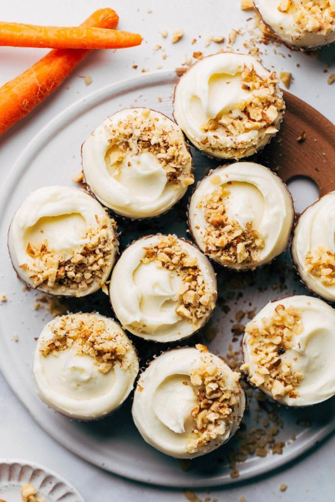 the top of carrot cupcakes topped with cream cheese frosting