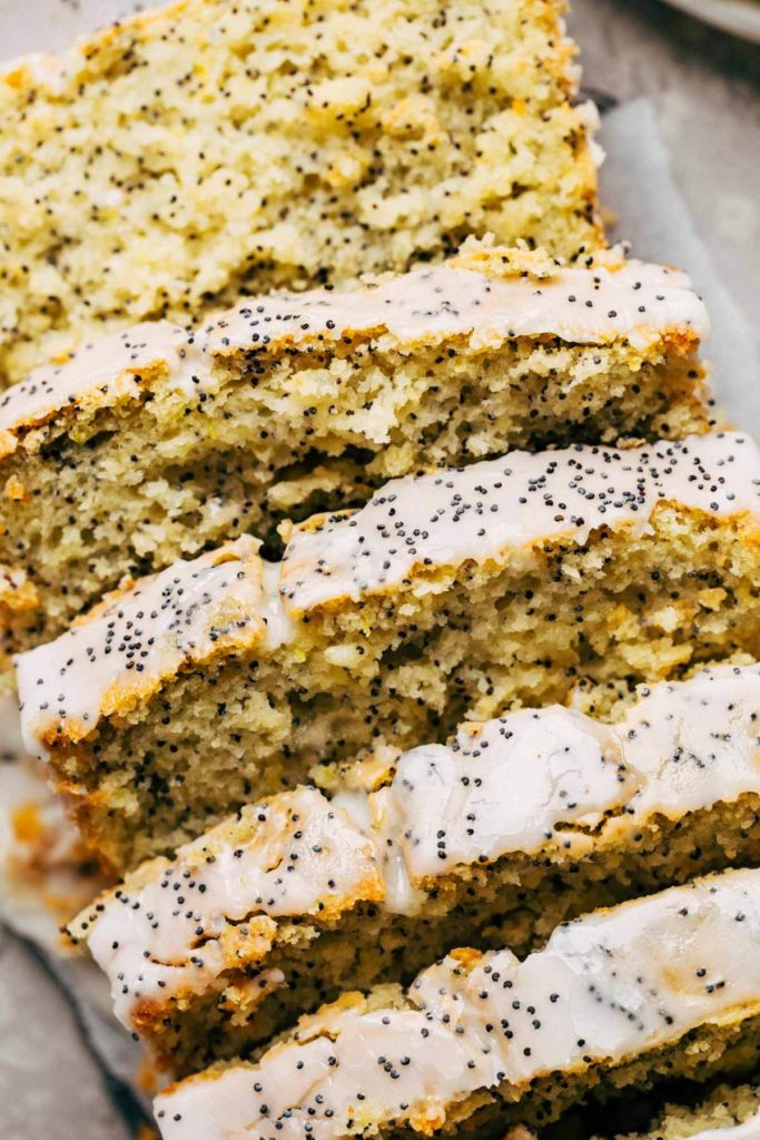 close up on a sliced loaf of lemon poppy seed bread