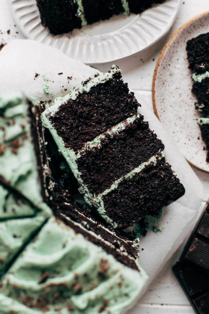 close up on a slice of mint chocolate chip layer cake