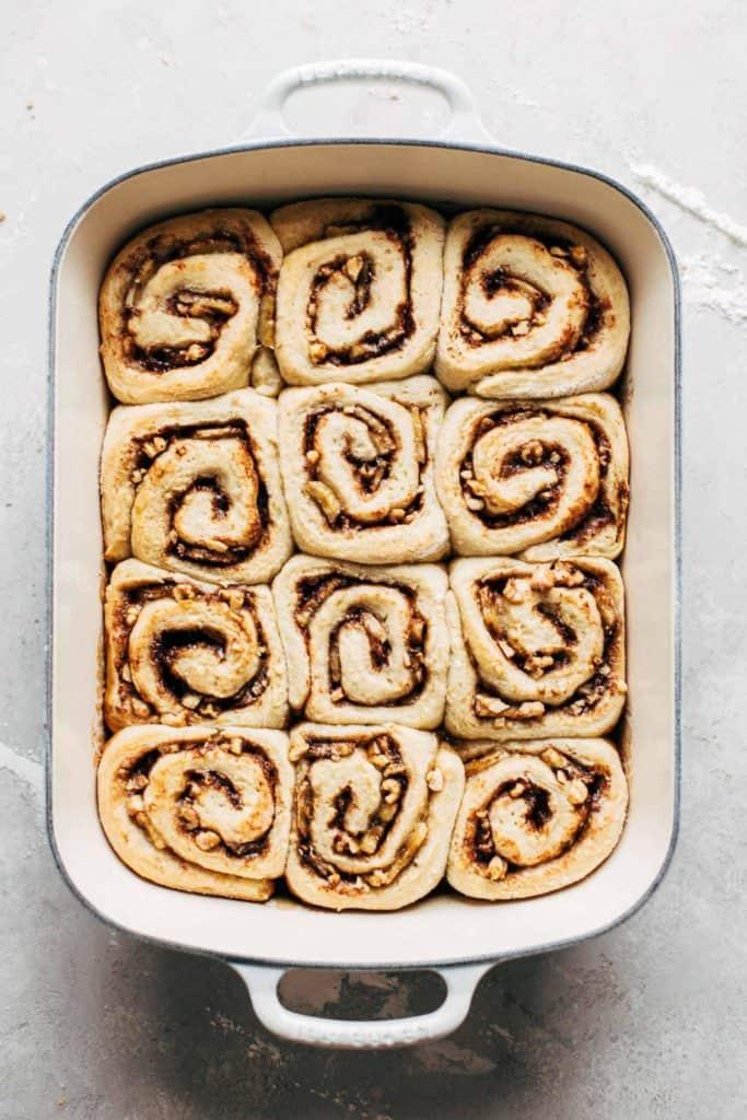 freshly baked cinnamon rolls in the baking pan