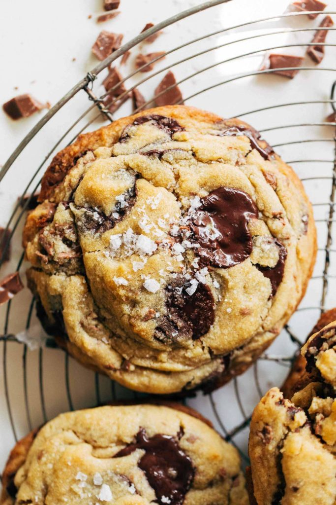 close up on the top of a large bakery style chocolate chip cookie