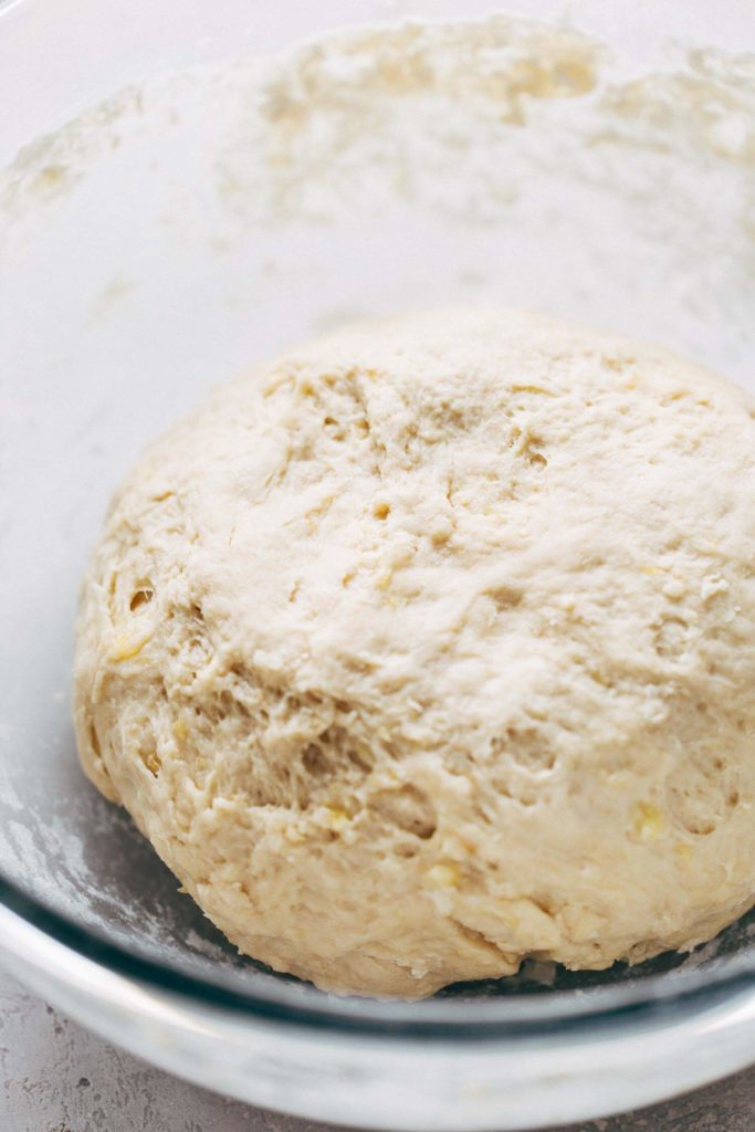 a ball of kneaded and smooth cinnamon roll dough