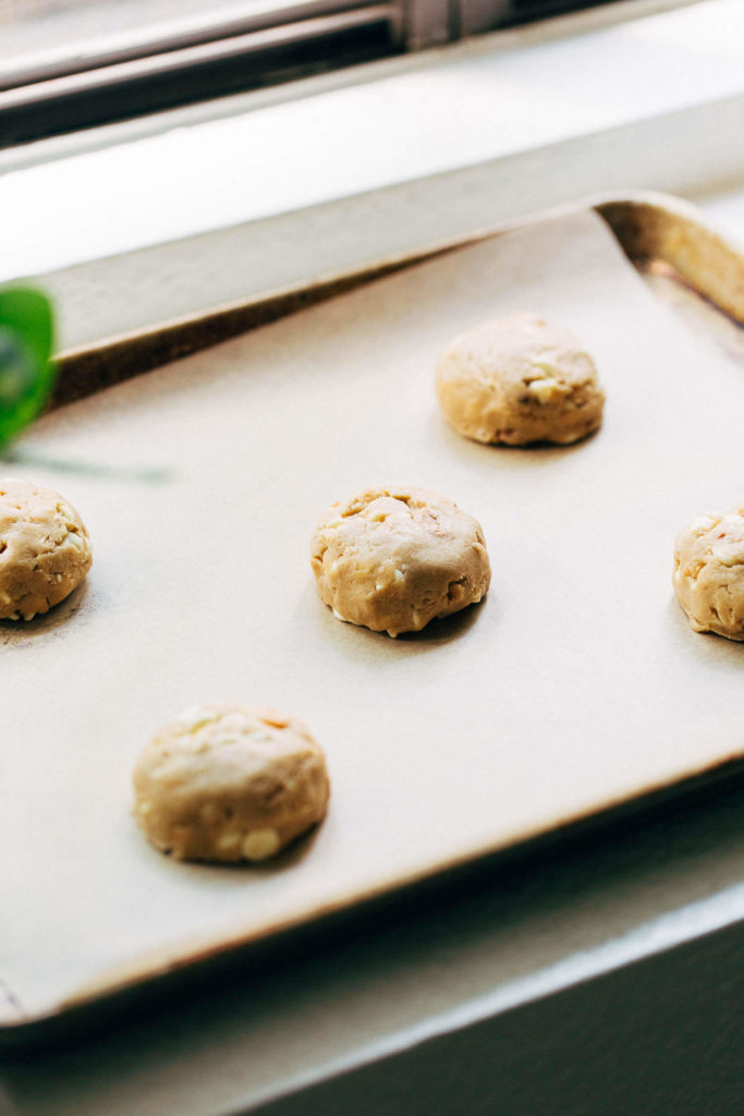 a baking sheet of scooped cookie dough