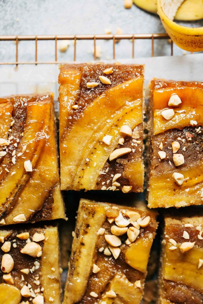 close up on the top of a slice of banana upside down cake