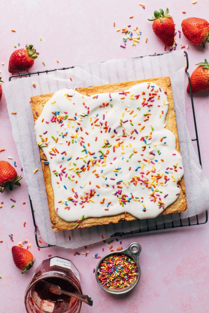 the top of baked shortbread topped with icing and sprinkles