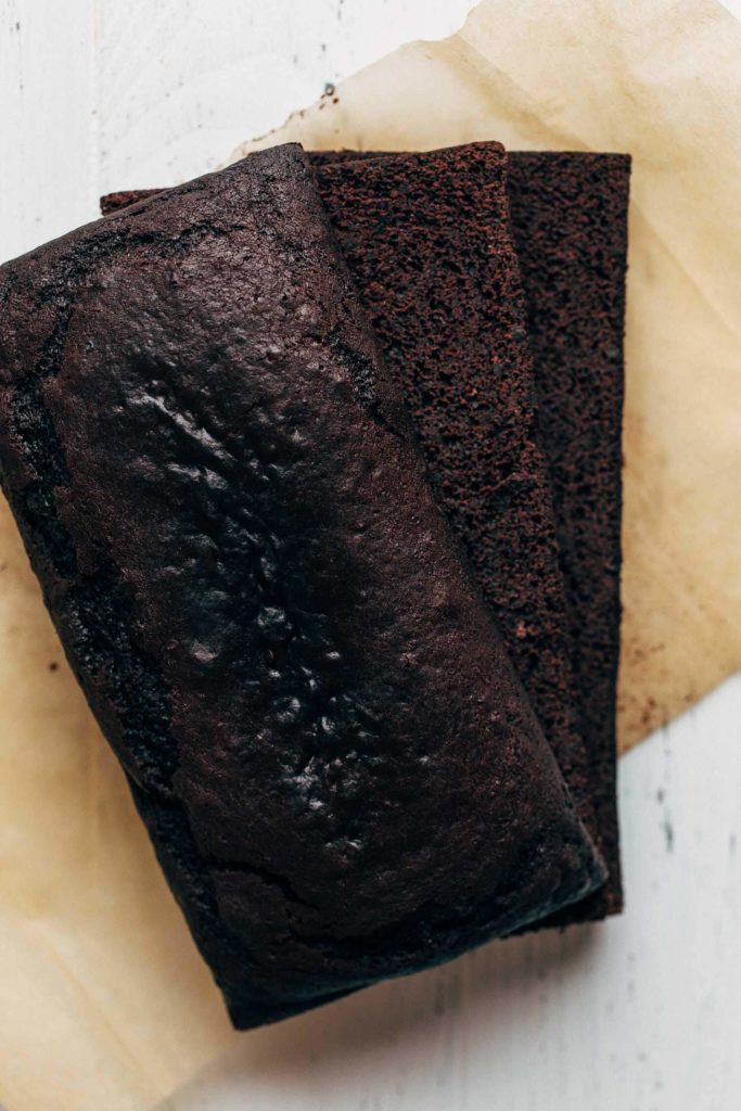 a chocolate loaf cake sliced into thirds