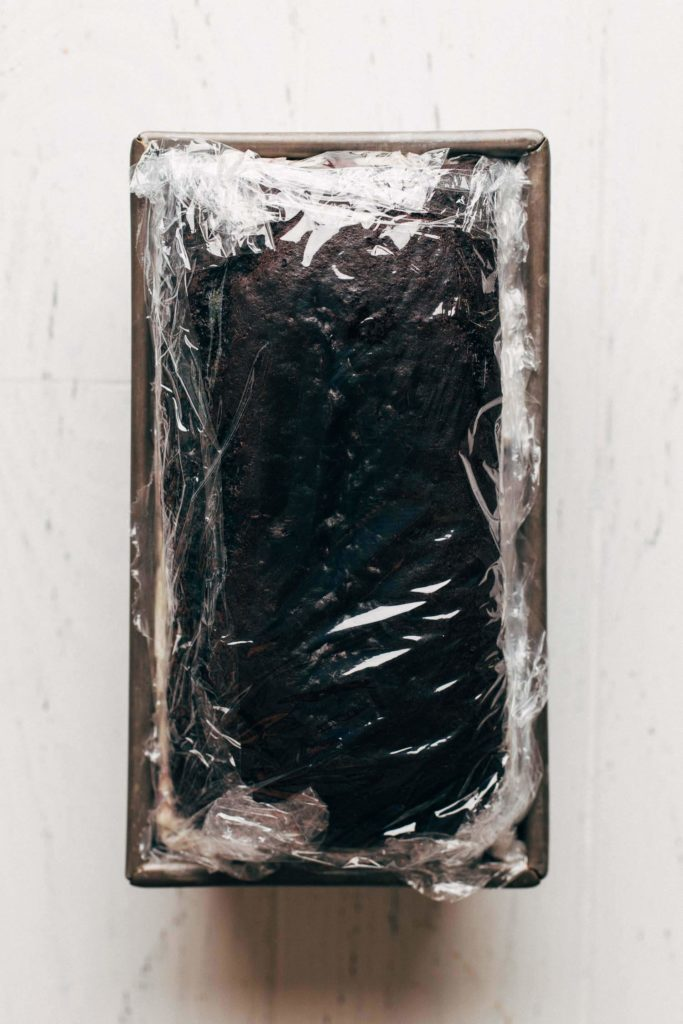 a chocolate ice cream cake wrapped up in a loaf pan