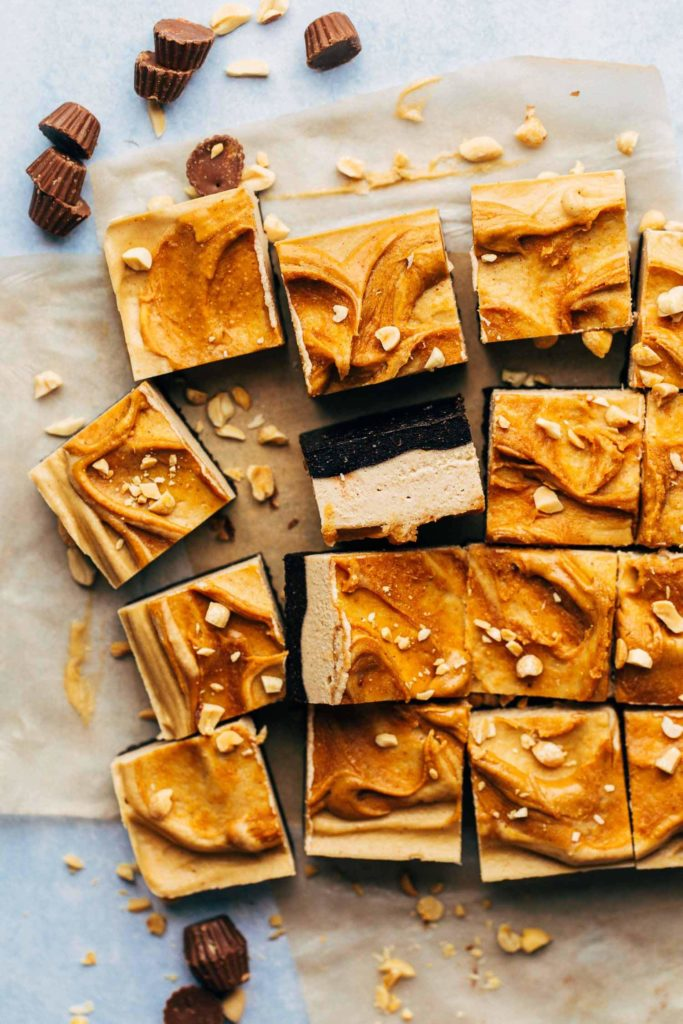 scattered pieces of peanut butter cheesecake bars