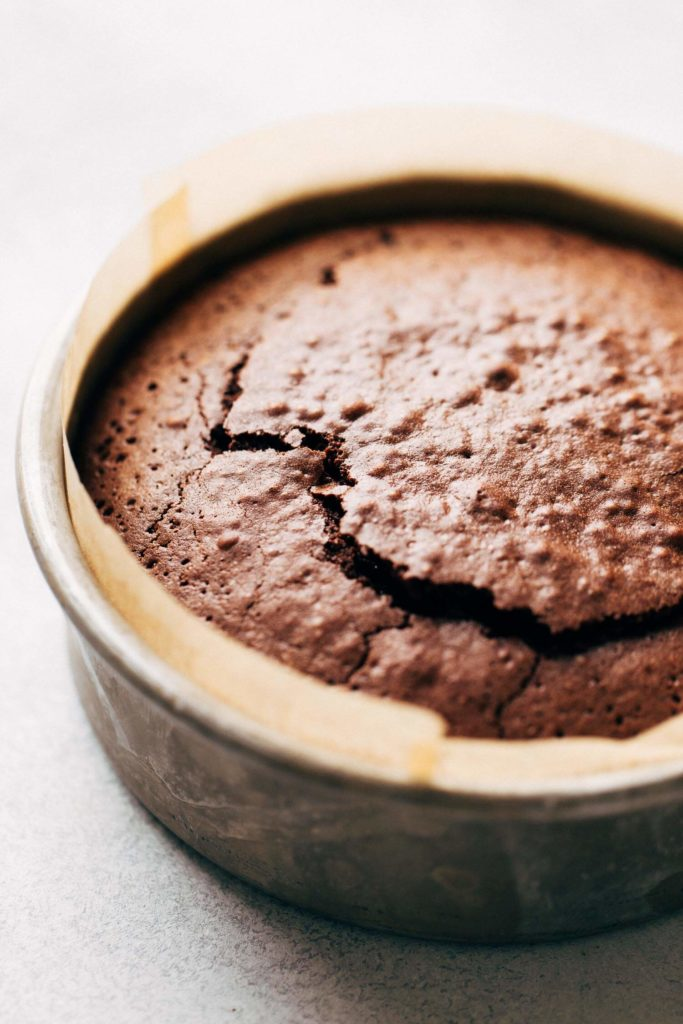 a freshly baked layer of brownie cake, still in the pan
