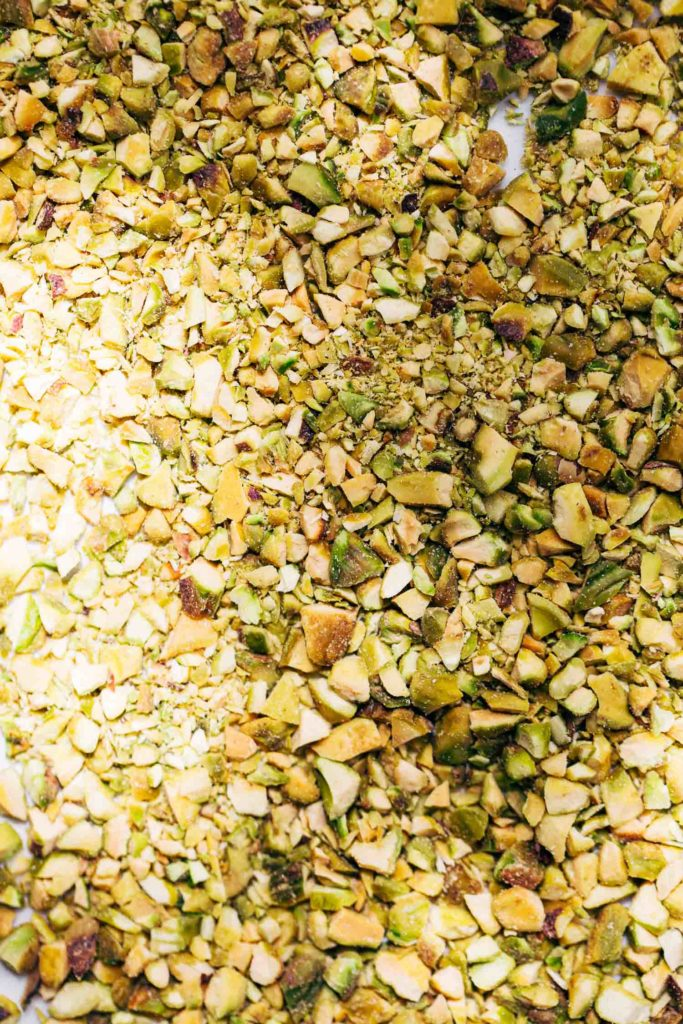 finely chopped pistachios spread even on a plate