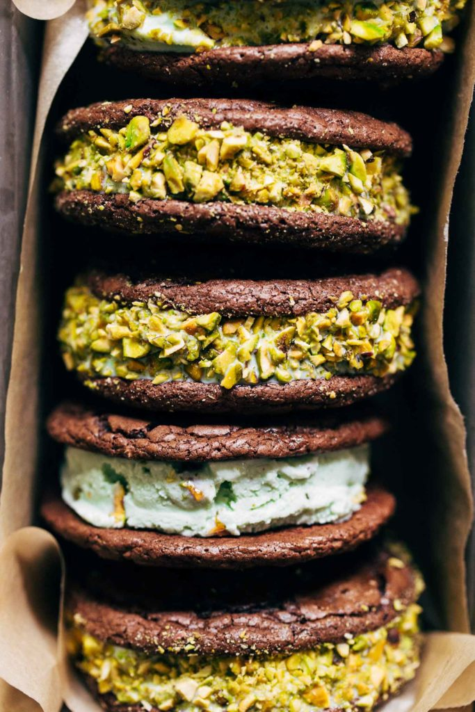 close up on brownie ice cream sandwiches in a tin