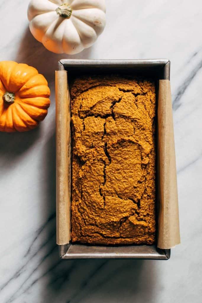 healthy pumpkin bread baked in a loaf pan