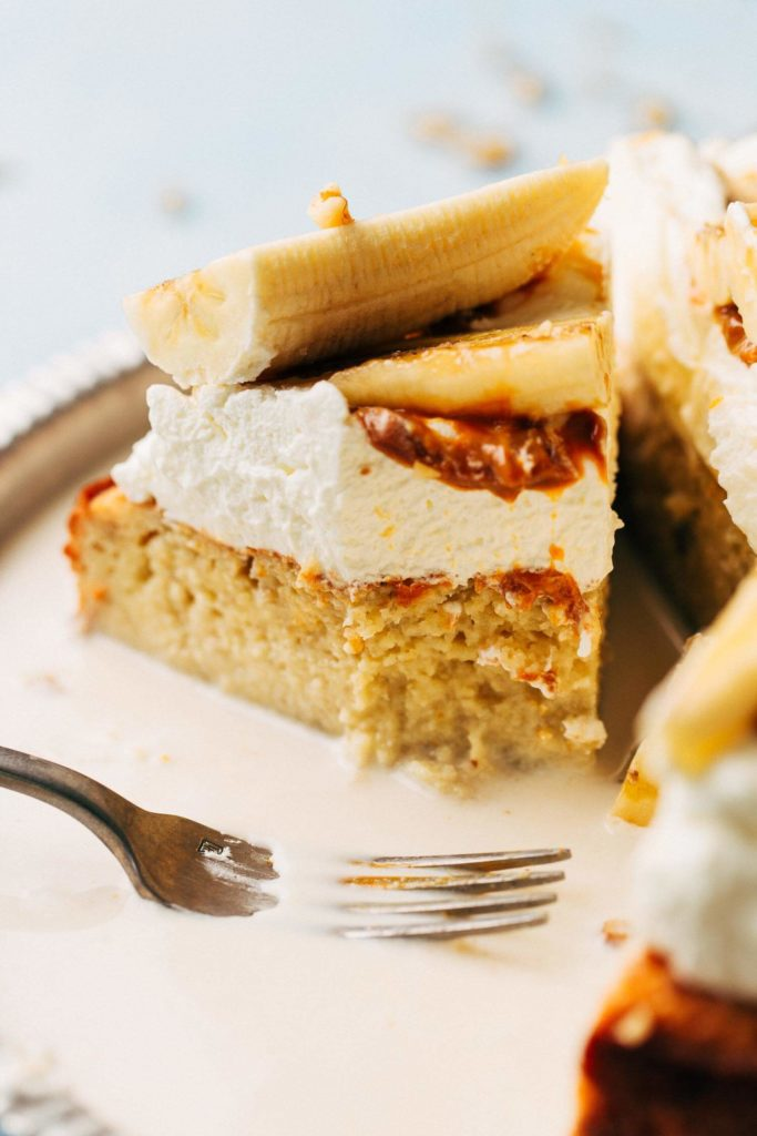 close up on a slice of banana tres leches cake