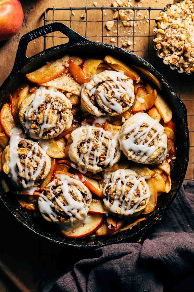 iced cinnamon roll biscuits on apple cobbler