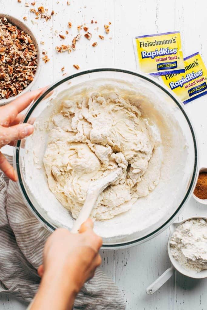 mixing cinnamon roll dough