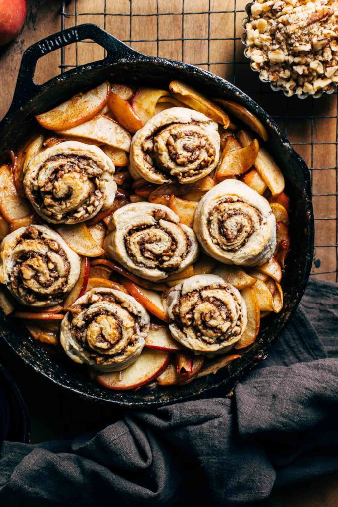 baked cinnamon roll biscuits on top of apple cobbler