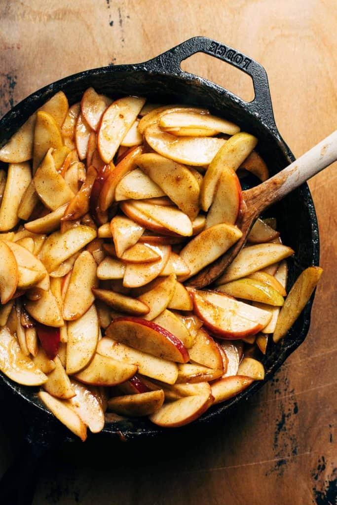 tender sautéed apples in a skillet