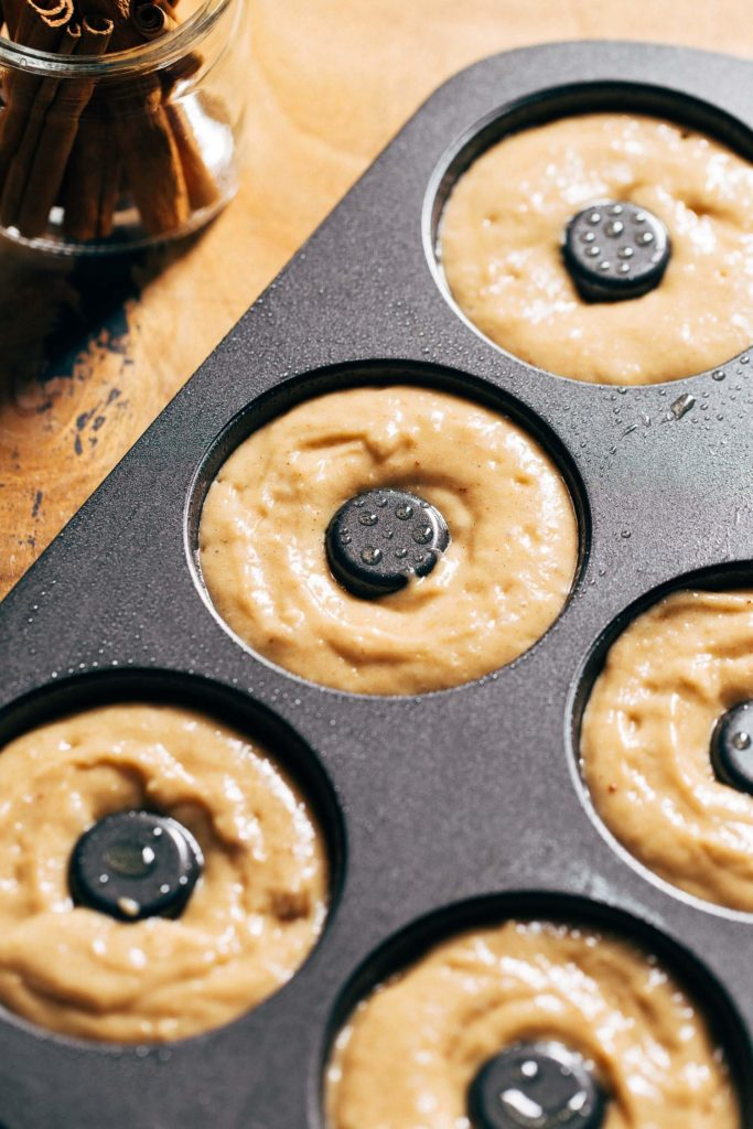 apple cider donut batter in a baking pan