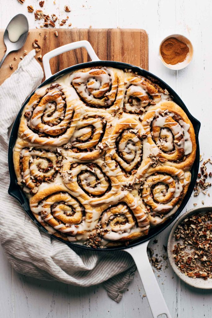 maple cinnamon rolls in a skillet