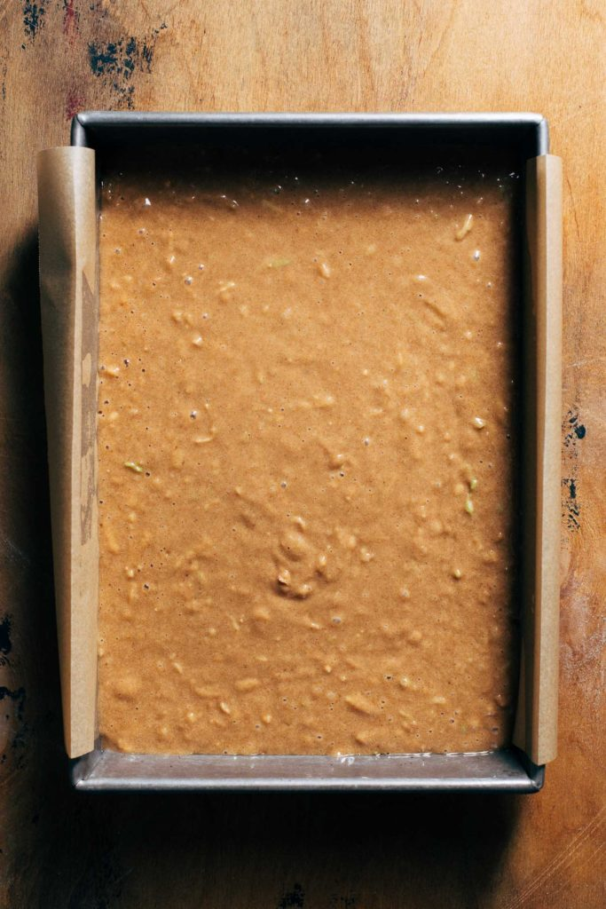 spice cake batter in a baking pan