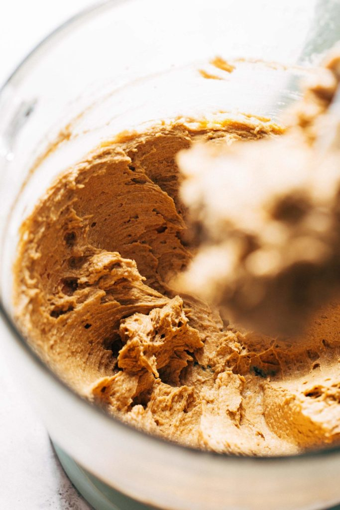 a bowl of spice cookie dough wet ingredients mixed together
